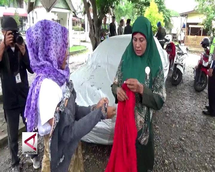 Sarung dan Kerudung Untuk Pelanggar Qanun