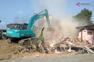 Video - Petugas bongkar paksa bangunan untuk proyek underpass