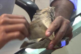 Menuju Bali bersih dari uang kertas lusuh